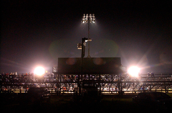 "8:35 p.m. -- The ""Friday night lights"" shine over Singletary Stadium at Newton High School as Newton takes on San Augustine High School Friday night.<br /> PHOTO/SCOTT ESLINGER                       OCT 1, 2004"