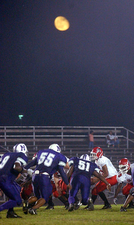 9:20 p.m. -- The moon rises over Singletary Stadium during the fourth quarter as Newton High School takes on San Augustine High School Friday night in Newton.<br /> PHOTO/SCOTT ESLINGER                       OCT 1, 2004