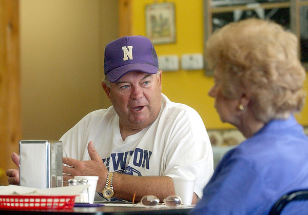 9:15 a.m. -- Newton High School football coach Curtis Barbay, left, speaks about that night's game to members of the Booster Club including Titter Hogan, of Newton, right, Friday morning at the Picket Fence restaurant in Newton.<br /> PHOTO/SCOTT ESLINGER                       OCT 1, 2004