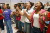 3:00 p.m. -- Newton High School students link fingers and pump their arms in a bicycle pedaling motion as they sing the school song Friday afternoon during a pep rally at the end of the school day.<br /> PHOTO/SCOTT ESLINGER                       OCT 1, 2004