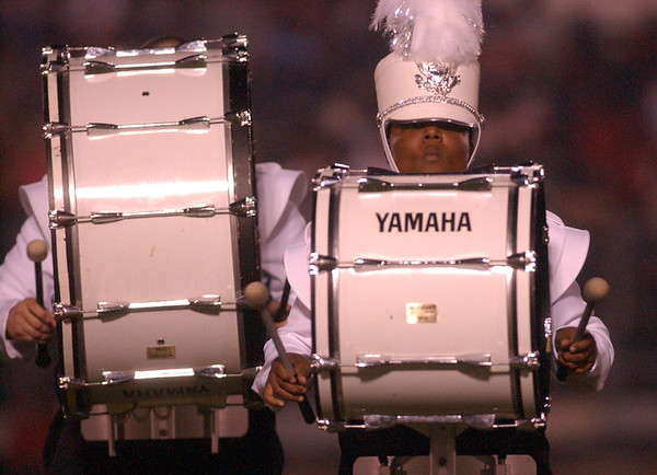 9:00 p.m. -- Bass drummers, LaQuenton Bevil, right, and James Thompson, left, perform with the Newton High School Marching band during half-time at Singletary Stadium in Newton.<br /> PHOTO/SCOTT ESLINGER                  OCT 1, 2004