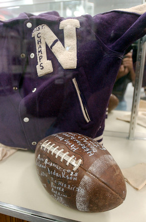 2:35 p.m. -- An old Newton High School letterman's jacket and an autographed football from ??? (see Jane) sit in a display case at the Newton County History Center Friday afternoon.<br /> PHOTO/SCOTT ESLINGER                       OCT 1, 2004