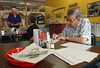 9:00 a.m. -- Longtime Newton Eagles fan Harold Hogan, 84, of Newton, fills out his picks for the football pool during the Friday morning meeting of the Booster Club at the Picket Fence restaurant.<br /> PHOTO/SCOTT ESLINGER                       OCT 1, 2004