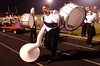 9:00 p.m. -- Newton High School marching band member, James Thompson, 17, clenches a drum mallet in his teeth as he carries his sousaphone and bass drum off the field after the band performed during half-time in Singletary Stadium. Because the marching band is  so small many of the members play more than one instrument and band members from the middle school also play at games.<br /> PHOTO/SCOTT ESLINGER                       OCT 1, 2004