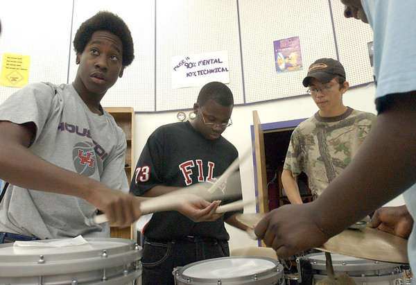 8:30 a.m. -- Newton High School marching band percussionists D.J. Holloway, 14, left to right, Eric Victoria, 16, Andy Hays 16, and Justin Robinson, 15, practice during first period  Friday morning for their half-time performance that night.<br /> PHOTO/SCOTT ESLINGER                       OCT 1, 2004