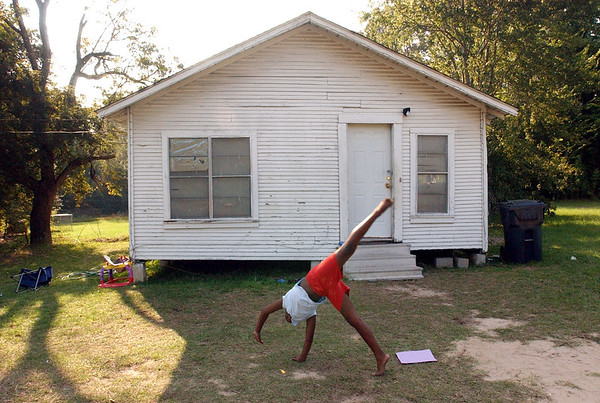 4:30 p.m. -- Fourth grader, Jamerica Brown, 9,  who dreams of being a cheerleader at Newton High School, practices her cheerleading in front of her home Friday afternoon in Newton.<br /> PHOTO/SCOTT ESLINGER                       OCT 1, 2004
