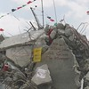 Palestinian colored flags placed on the top of a destroyed building in the center of Jenin during the height of the second Intifada April 2002.