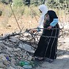 Woman collecting firewood near Hebron during the height of the Intifada.