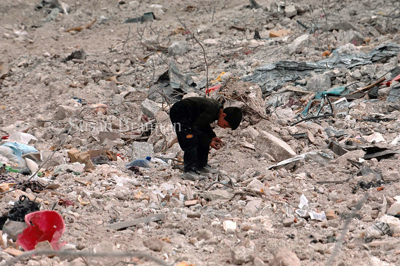 A boy picks through the rubble in Jenin.