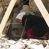 A woman trying to find items after her home was destroyed during a mass sweep from Israel during Operation Defensive Shield in Jenin.
