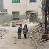 Two Palestinian girls walking home from school in Rafah, Gaza.