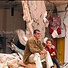 Father and child sitting in front of their destroyed home after the first Israeli incursion into Bethlehem.
