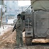 Israeli soldiers patrolling the streets in downtown Ramallah, during the imposed 24 hour closures on the local residents in March-April 2002.