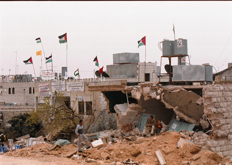 Palestinian flags are placed over the destroyed buildings in Bethlehem after the first Israeli incursion.