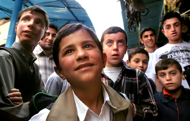 With his command of English, Ricky, center, is the envy of other boys in Dohuk.