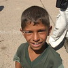 An Iraqi boy looking at his image in my lens.