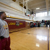 Aaron Brand (head football coach) awaits Jason Richardson's appearance at West Charlotte HS gym.