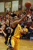 The Explosion's Donald Watts goes up for the layup