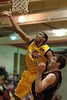 The Explosion's Rashaad Powell goes up for the layup against the Snohomish County All Stars Tim Getsch