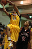 The Explosion's Rashaad Powell goes up for the layup against the Snohomish County All Stars Jordon Estill
