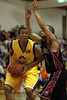 The Explosion's strong forward Rashaad Powell goes up for the layup against the Snohomish County All Stars Jordon Estill