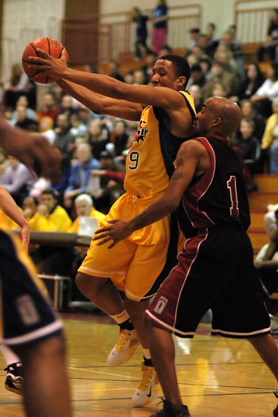 The Explosion's Rashaad Powell drives past the Snohomish County All Stars Antwon Jones