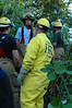 Firefighter Rob Orton instructs members of Fire Explorer Post 444 in the creation of a firebreak for containment of brush or forest fires.