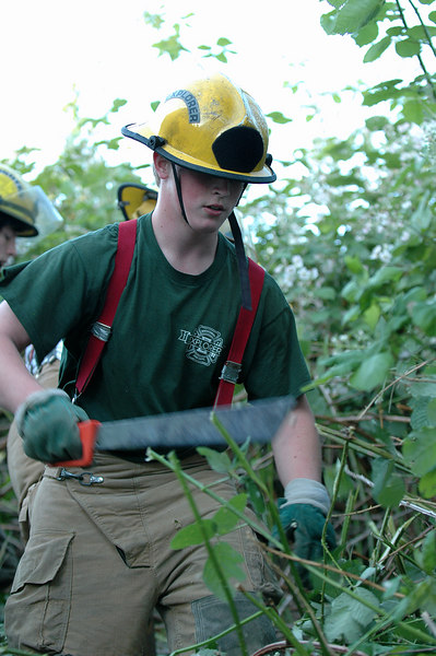 Sean Watson takes the lead with the machete in clearing the firebreak
