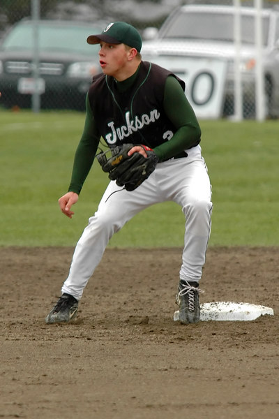 Jackson's Chris Lynch prepares to take the throw from the catcher during a steal attempt.