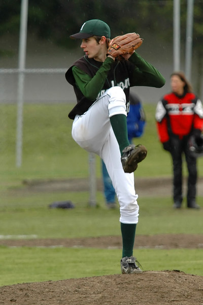 jackson's Ryan Charwell pitching in the first inning against Cascade in the rain
