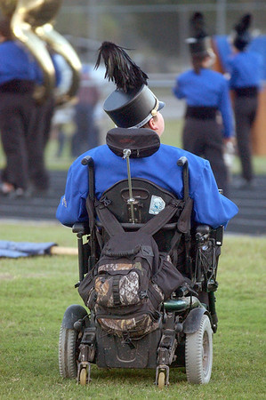 Hamshire Fannett High School marching band percussionist Jeremy Sohoski, 16, of Fannett, who has Duchenne muscular dystrophy, gets ready for a performance by the band before an October home game.<br /> PHOTO/SCOTT ESLINGER                   OCT 15, 2004