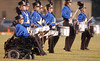 Jeremy Sohoski, 16, of Fannett,who has Duchenne muscular dystrophy, plays the cowbell with the precussion section of the Hamshire-Fannett High School marching band as they perform before a football game on a Friday evening in October.<br /> PHOTO/SCOTT ESLINGER                   OCT 15, 2004<br /> 1015_Jeremy164.jpg