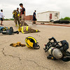 The students at the LBJ High School Fire Academy run through drills using the same gear as regular firefighter recruits.