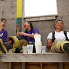 Three participants in the LBJ High School Fire Academy joke around during a break in their training.