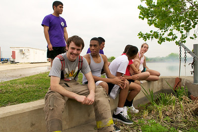 Participants in the LBJ High School Fire Academy rest during a break in a training day.  Some students, such as the one in front of this photo, plan on pursuing a firefighter career after graduation from high school.