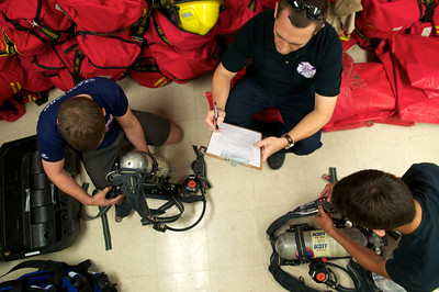 Two participants run through a skills assessment on using the oxygen masks during their class time at the LBJ High School Fire Academy.