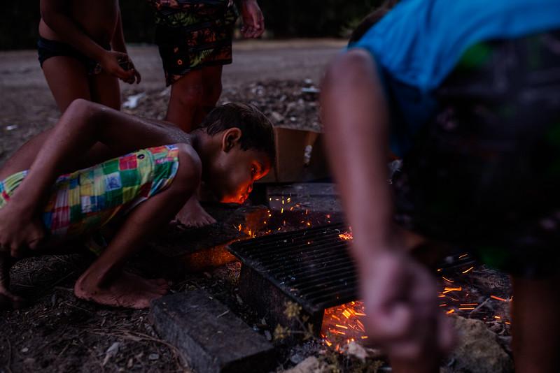 Nicholas Martin breathes life into the campfire