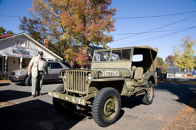 Veteran Jack Tobin COL(R) SF inspects a World War II era jeep.
