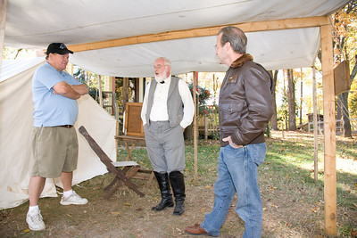 Veterans Steve Attell of Mint Hill and William Griffin of Mint Hill speak with Andrew Shores (General Lee) of Ramseur, NC.