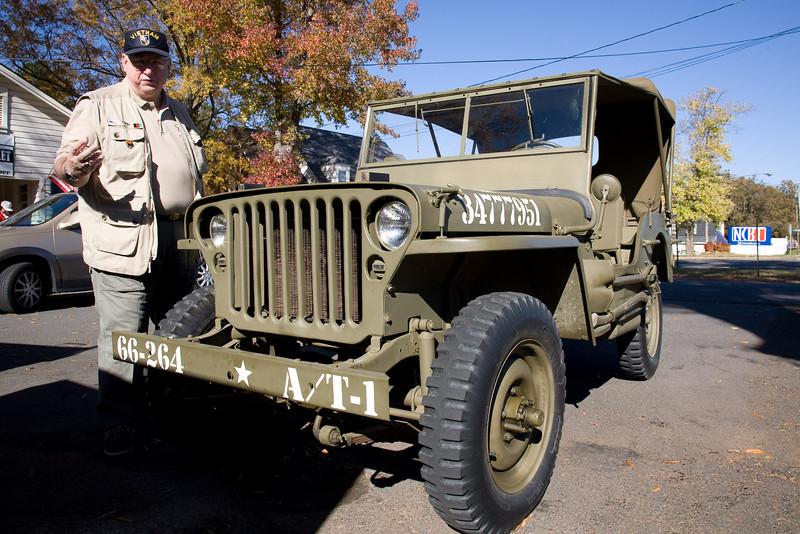 Veteran Jack Tobin COL(R) SF inspects a World War II era jeep.