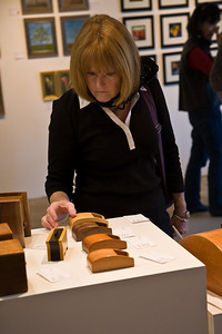 A woman checks out the art at Mint Hill Art.