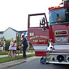 Wesley Chapel Fire Dept. Captian Larry Mckinney hands out treats and candy to some of the children of Providence Glenn.