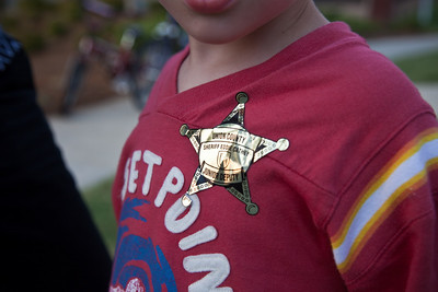 "Caden shows off his ""junior deputy"" badge sticker"