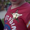 "Caden shows off his ""junior deputy"" badge sticker"