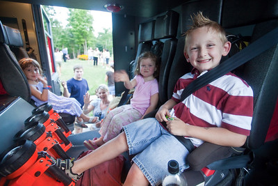 Left to Right, Brooklyn Warner (blue dress),  FIreman Bo Brooks with navy blue shirt, Julie Staley, Rachel Staley (pink top) Malachai Cooper (red white shirt) check out the back row of seats in the ladder truck.