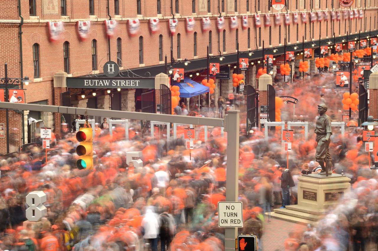 4..5.2016 BALTIMORE, MD- Throngs of fans stream into Oriole Park at Camden Yards Monday afternoon for the Baltimore Orioles' Opening Day.The image was captured using a 30 second exposure and the use of a neutral density filter, showing the movement of the crowd into the Eutaw Street entrance. (The Daily Record/Maximilian Franz)