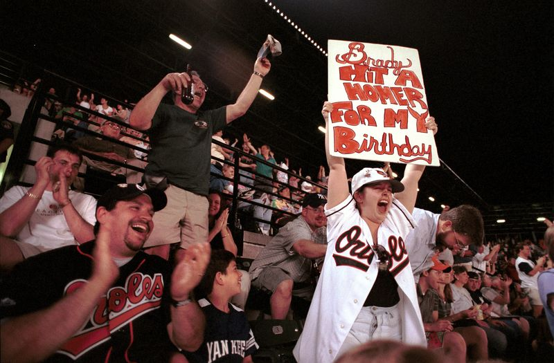 Fans at an Orioles Game chear after their team hits a homerun in the top of the 8th. 8/6/99 Maximilian Franz/The Daily Record