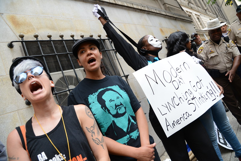 6.23.2016 BALTIMORE, MD- Protestors demonstrate outside of the Baltimore City Circuit Courthouse awaiting the verdict in the trial of Officer Caesar Goodson, the driver who was charged in the Freddie Gray murder case. (The Dailly Record/Maximilian Franz)