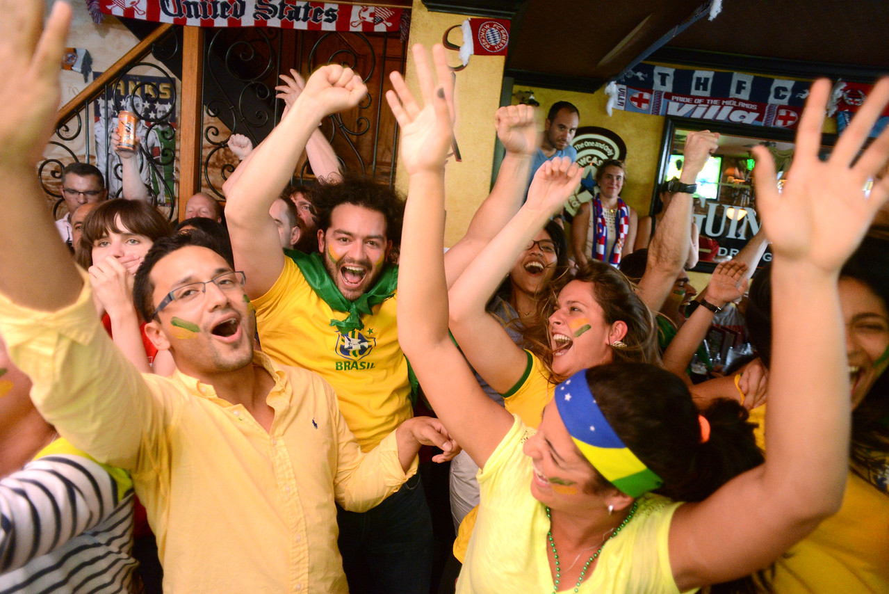 6.12.2014 BALTIMORE, MD- A group of Brazilian Students from the Johns Hopkins School of Medicine congregated at Slainte Irish Pub and Restaurant to cheer their nation's team in the the opening game of the 2014 World Cup. (The Daily Record/Maximilian Franz)