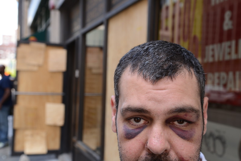 04.28.15 BALTIMORE, MD- Egyptian native and Baltimore resident Alaa Mansour, was working part time at the Gold Apple Watch and Jewelry Repair on East Fayette street in Balimore with rioters caught him outside of the store when trying to leave on Monday around 5:30pm, beat him to the ground and stole $470 of his person. (The Daily Record/Maximilian Franz)